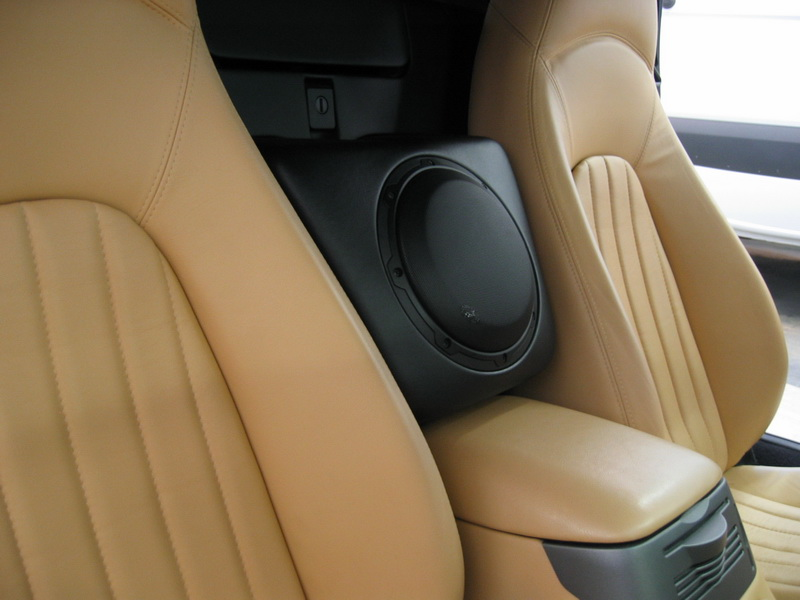 Sub Enclusre installed in between the seats of the car